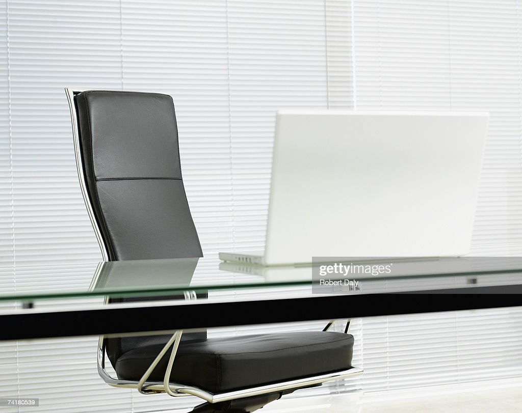 Empty office chair with laptop on desk : Stock Photo