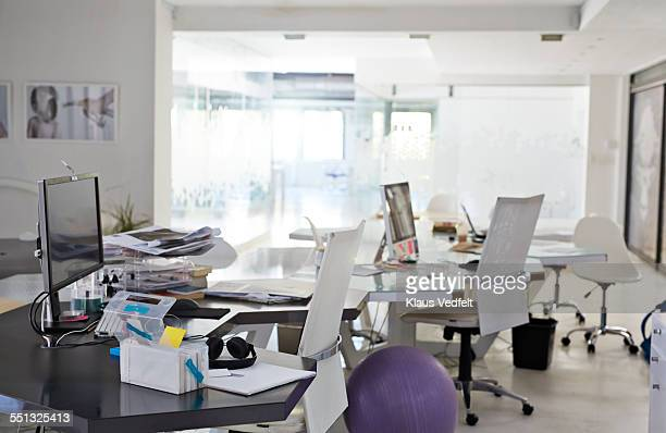 Empty office, messy desk at design agency