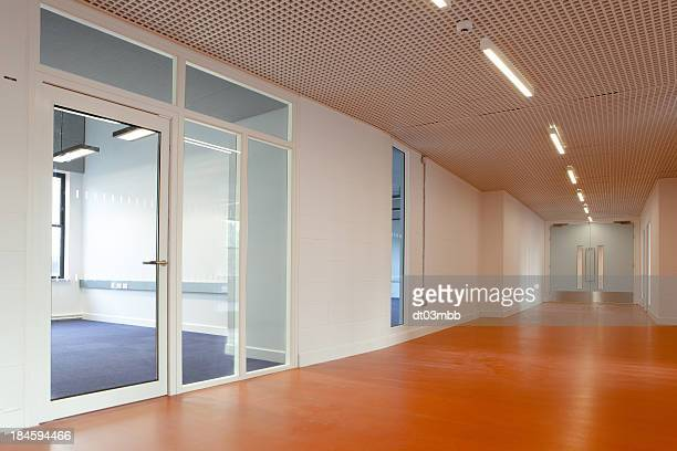Empty office space featuring a laminate wood floor corridor