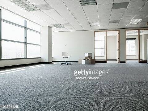Empty office with boxes and one chair : Stock Photo