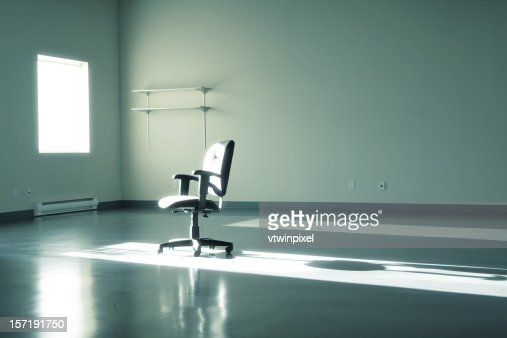 Empty office with chair sitting in the sun