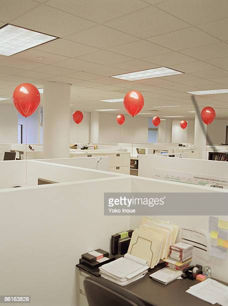 Empty office with red balloons