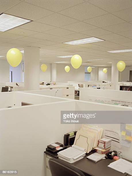 Empty office with yellow balloons