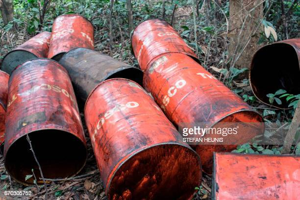 Empty oil drums are seen at the site of a recently destroyed illegal oil refinery on April 19 2017 in the Niger Delta region near the city of Warri...