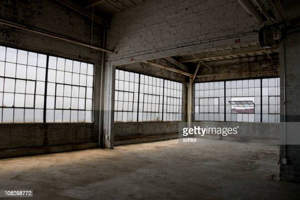 Empty, old, abandoned factory warehouse
