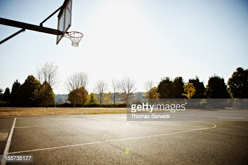 Empty outdoor blacktop basketball court