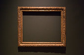 Photograph of an empty painting frame in a museum