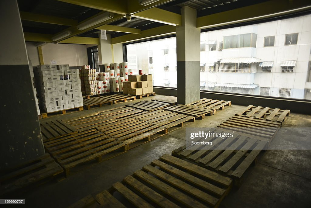 Empty pallets sit at a private sector food distributor's warehouse in central Caracas, Venezuela, on Monday, Jan. 14, 2013. According to the manager, he has not been able to stock basic food items like sugar, coffee, meat or milk for weeks because of nationwide food shortages. The government is conducting a nationwide campaign to crack down on over-pricing and hoarding it blames for shortages of basic goods, from toilet paper to sugar. Photographer: Meridith Kohut/Bloomberg via Getty Images
