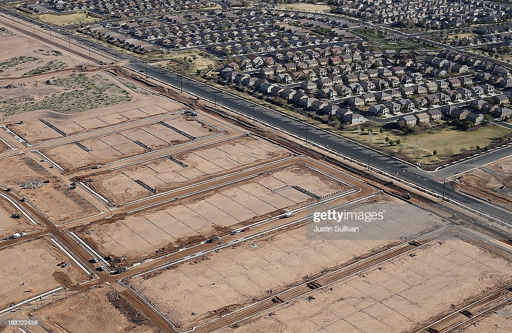 Empty parcels of land and unfinished roads sit next to a housing development on March 6, 2013 in Mesa, Arizona. In 2008, Phoenix, Arizona was at the forefront of the U.S. housing crisis with home prices falling 55 percent between 2005 and 2011 leaving many developers to abandon development projects. Phoenix is now undergoing a housing boom as sale prices have surged 22.9 percent, the highest price increase in the nation, and homebuilders are scrambling to buy up land.