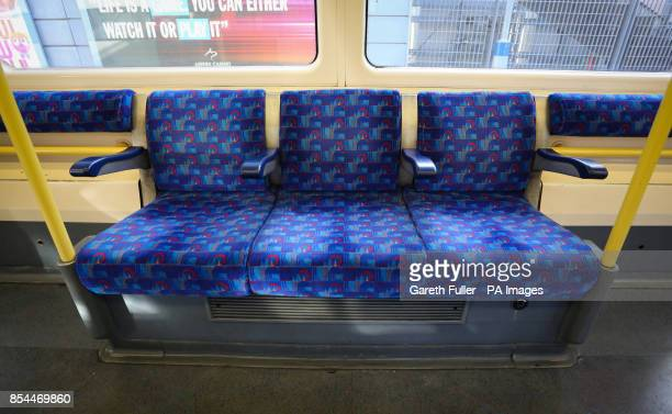 Empty passenger seats on a tube train in London as commuters face a 48 hour tube strike which starts this evening