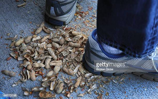 Empty peanut shells beneath the shoes of Rob McMorrow from Concord The Baltimore Orioles play the Boston Red Sox during Opening Day at Fenway Park