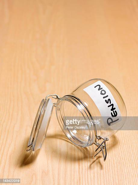 Empty pension pot on wooden background