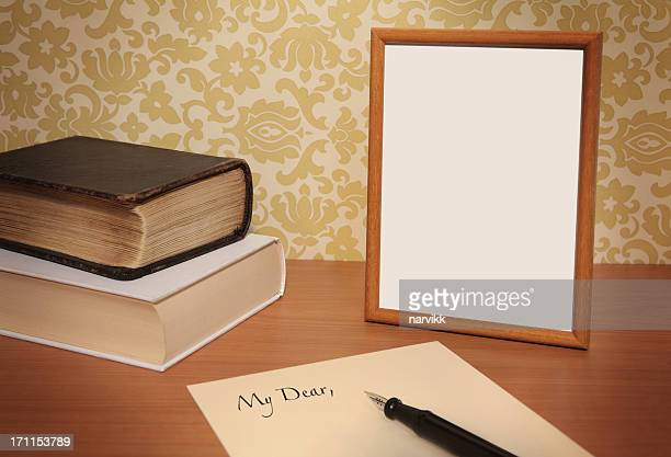 Empty Photo Frame and Letter on the Table
