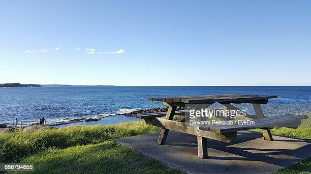 Empty Picnic Table Against Sea