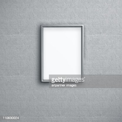 Empty picture frame hanging on a wall