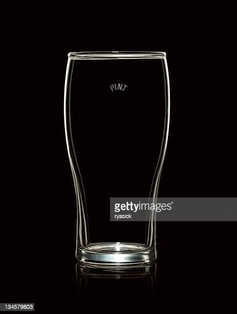 Empty Pint Beer Glass Isolated on Black Background