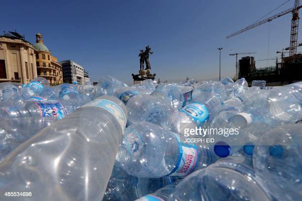 Empty plastic bottles are seen piled up by Lebanese activists in order to be recycled on August 28 on Beirut's Martyrs Square The 'You Stink'...