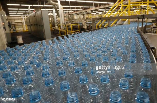 Empty plastic bottles move down a production line to be turned into Dasani bottled water at a CocoCola bottling plant on February 10 2017 in Salt...