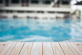 empty plywood and blur swimming pool background can be used for product display template