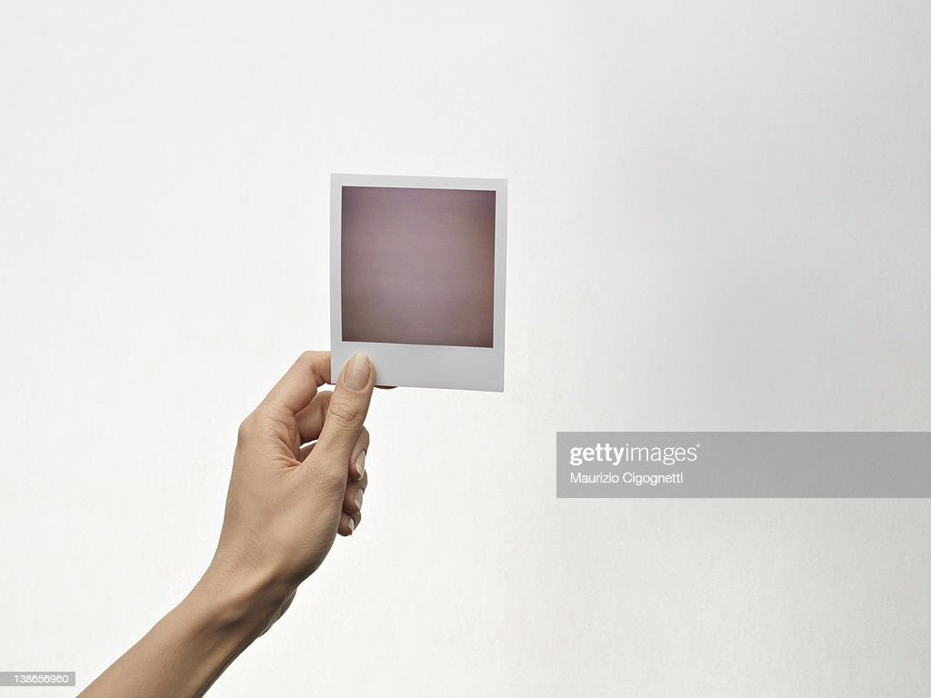 empty polaroid held in one hand free pc rf stock photo getty images. Black Bedroom Furniture Sets. Home Design Ideas