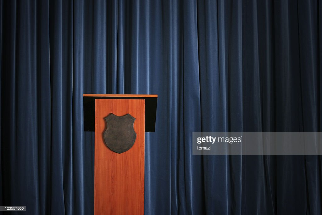 Empty press conference room with a wooden podium