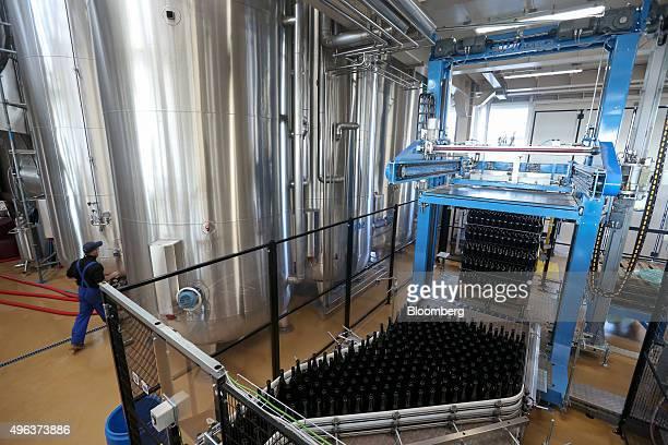 Empty Prosecco wine bottles move along a conveyor belt before filling at Cantina Sociale Cooperative Agricola di Vittorio Veneto winery in Conegliano...