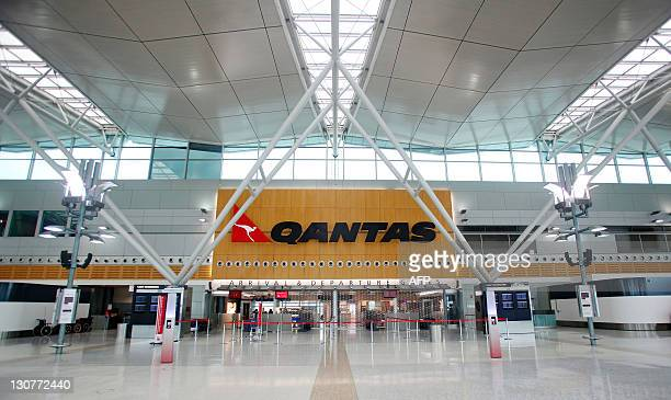 Empty Qantas checkin lines and a lockedup departure gate are pictured at the domestic terminal at Sydney International Airport on October 30 2011 a...