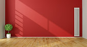 Red Living Room with  vertical heater and plant - 3D Rendering