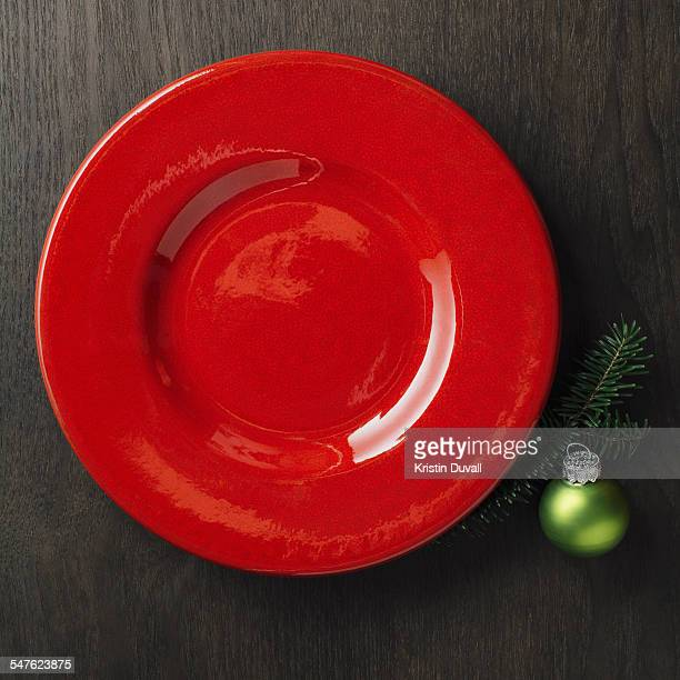 Empty red plate with Christmas decorations