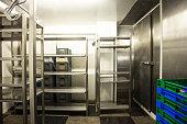 Empty restaurant kitchen storage room stainless steel