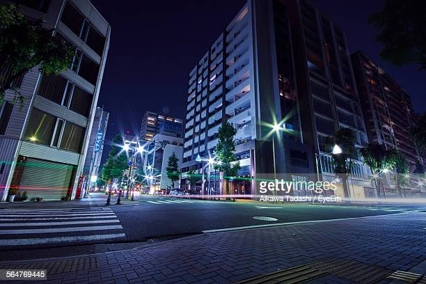 Empty Road Against Buildings At Night