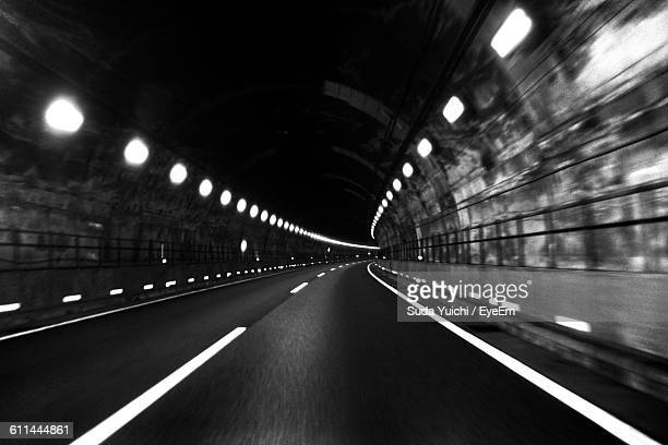 Empty Road Along Lights In Tunnel