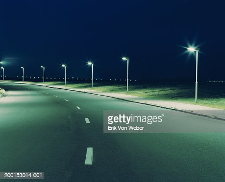 Empty road and streetlights at night : Stock Photo