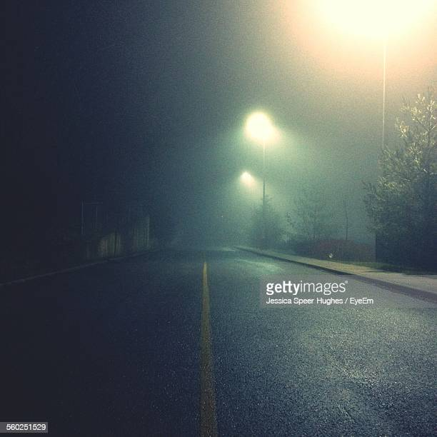 Empty Road At Night In Fog