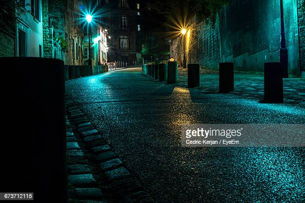 Empty Road By Houses On Street At Night