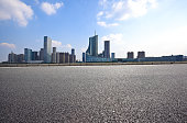 Empty road floor with City modern building background skyline