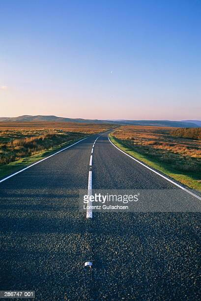 Empty road in flat landscape