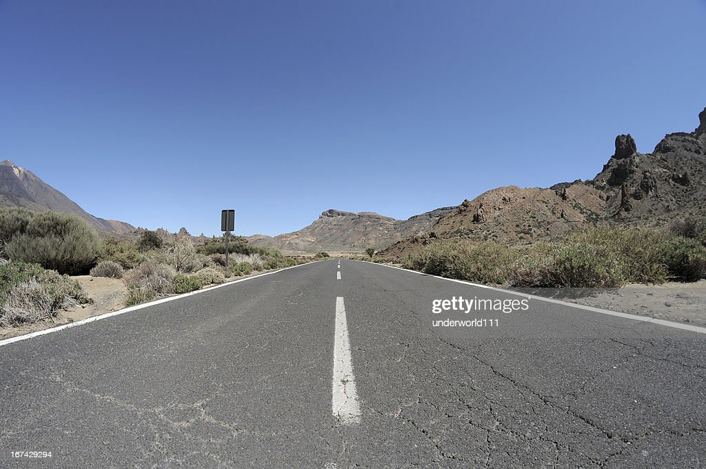 Empty road in the desert to infinity : Stock Photo