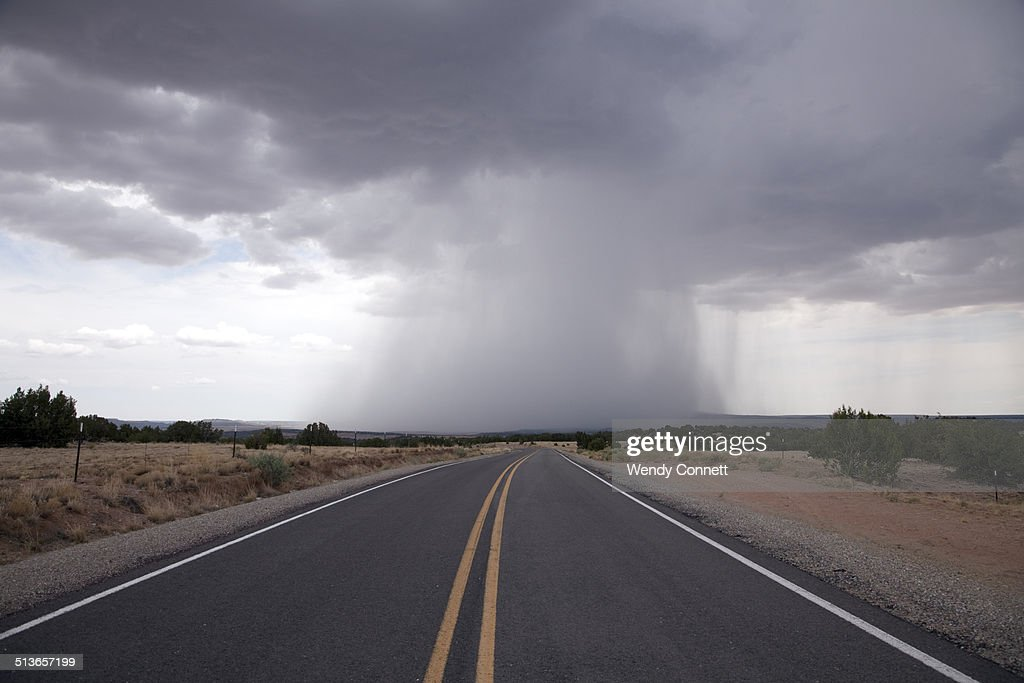 Empty road with storm clouds