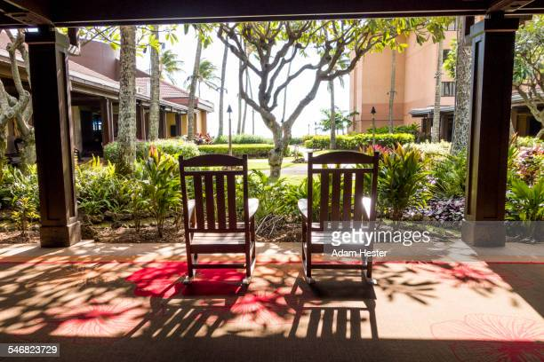Empty rocking chairs on hotel porch