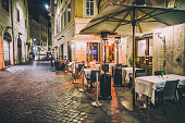empty restaurant tables in the street of Rome. Italy