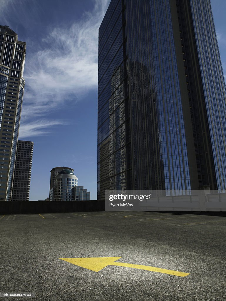Empty rooftop carpark amongst skyscrapers : Stock Photo