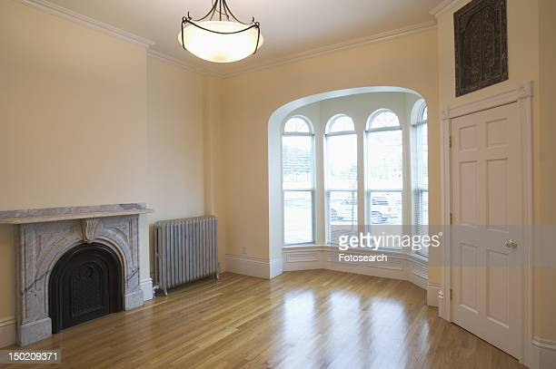Empty room in apartment with hardwood floor and bay window
