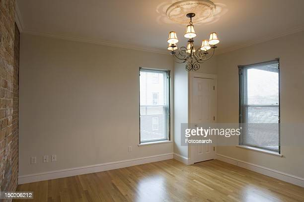 Empty room in apartment with hardwood floor