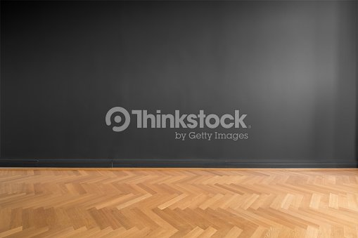 empty room with black wall background and wooden parquet floor : Stock Photo