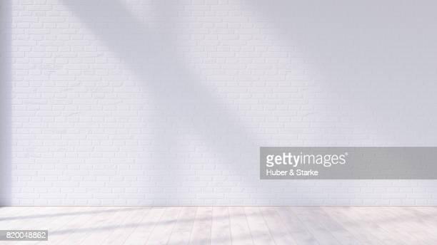 empty room with brick wall and hardwood floor