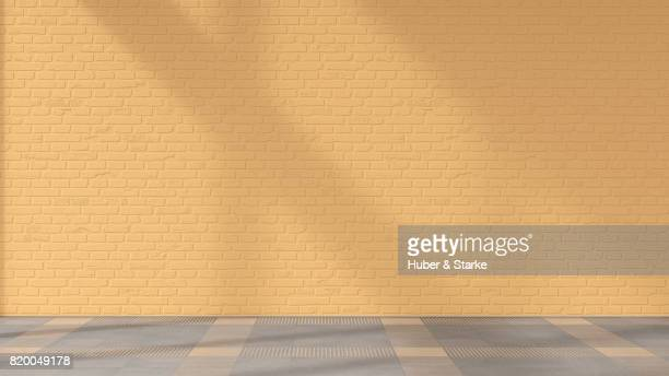 empty room with brick wall and tiled floor