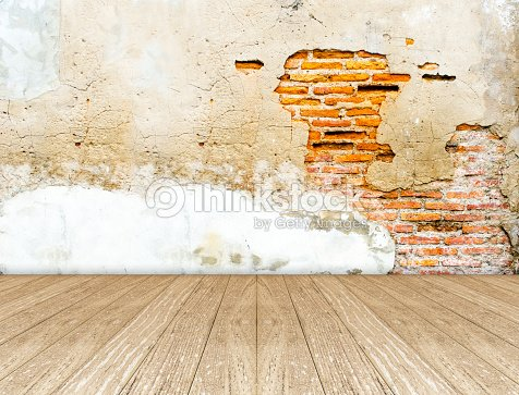 Empty Room With Crack Brick Wall And Wooden Floor Stock Photo