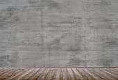 Empty room with old dark grey concrete grunge wall with brown wooden planks