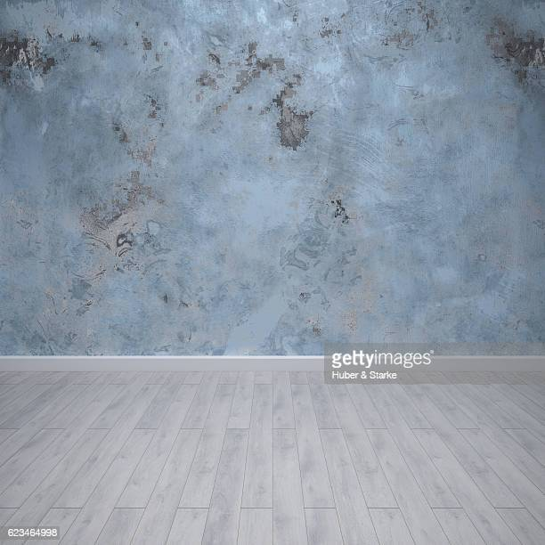 Empty room with modern painted wall and wooden floor